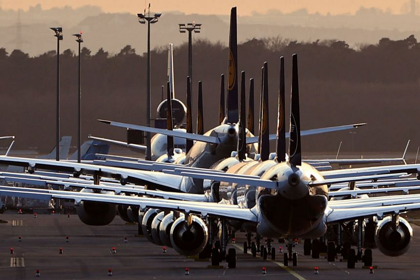 Planes of German carrier Lufthansa are parked at the airport in Frankfurt, on March 15, 2020.