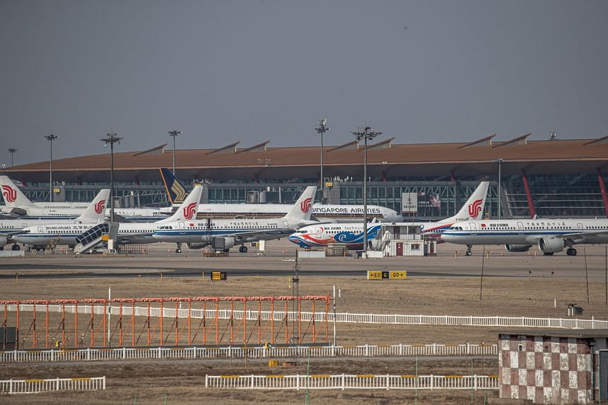 Planes parked at the Capital International Airport, in Beijing, China, on March 17, 2020.