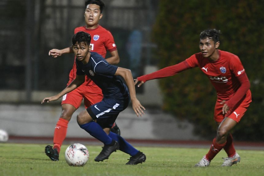 Young Lions striker Khairin Nadim (in blue) in action against Home United in a pre-season friendly.