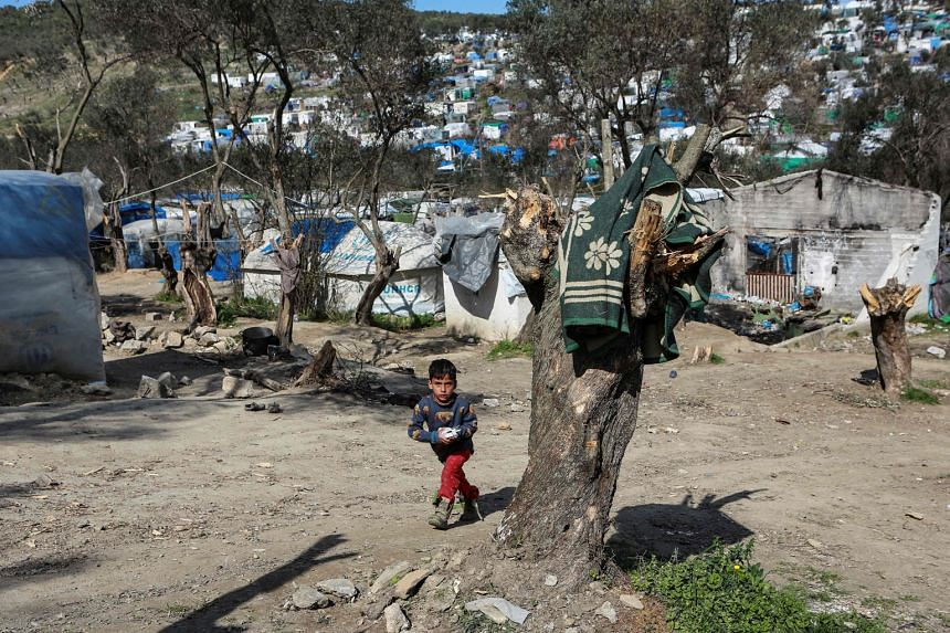 A child in the refugee camp of Moria on the Greek island of Lesbos on Monday. The EU has urged Turkey to stop migrants in the country - from Afghanistan, Pakistan, Syria and countries in Africa - from trying to cross the border to Greece and on to th
