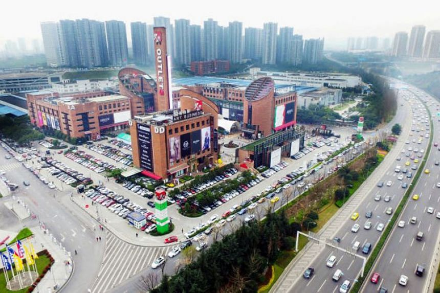 An outlet mall in Chongqing which is part of Sasseur Reit's portfolio. The Reit manager closed all its four malls in late January in response to the spread of the coronavirus in China. The Chongqing mall was reopened on Sunday.