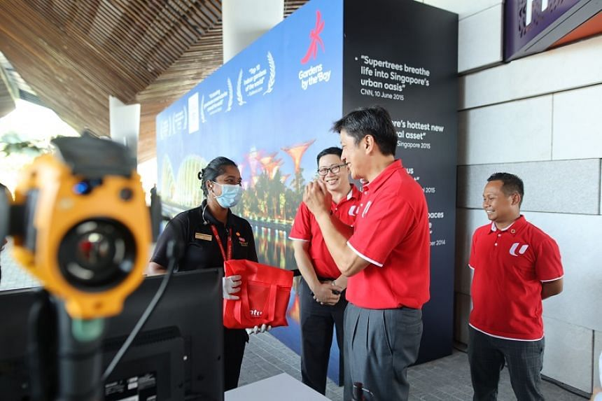 NTUC secretary-general Ng Chee Meng speaking to a worker at the Gardens by the Bay on March 18, 2020. He said workers have shared that their biggest concerns centre around sustaining their livelihoods and caring for their loved ones.