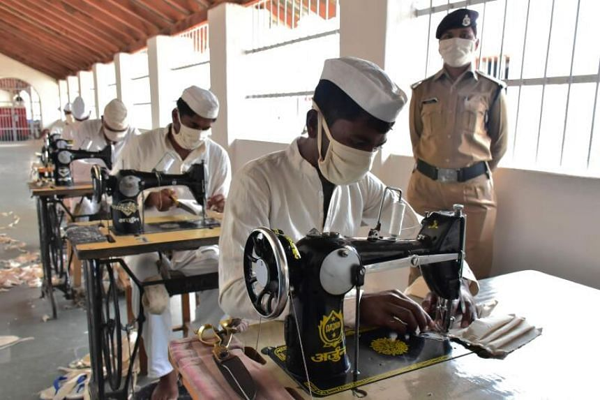Inmates making face masks as part of a project inside the Netaji Subhash Chandra Bose central jail, in Jabalpur, India, on March 15, 2020.