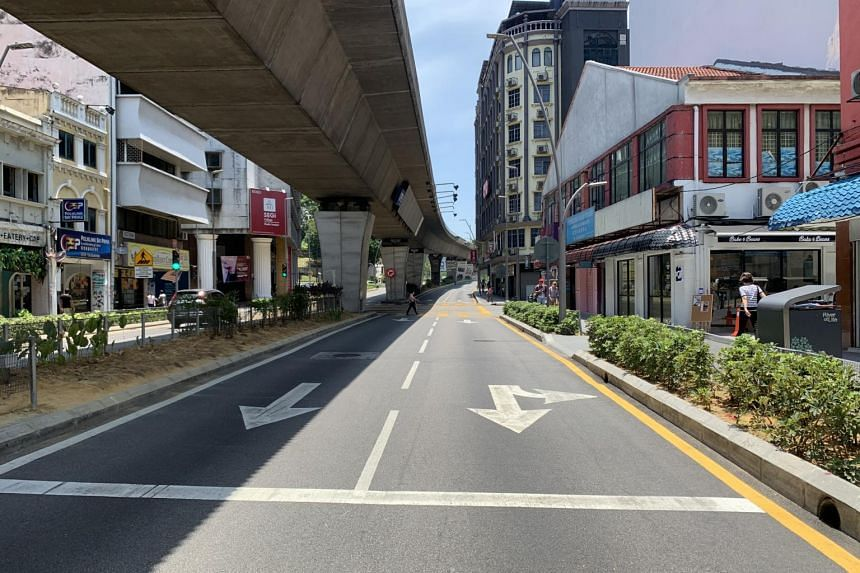 Empty roads in downtown Kuala Lumpur are seen on the first day of the Movement Control Order issued by the newly formed Perikatan Nasional government in Malaysia, on March 18, 2020.