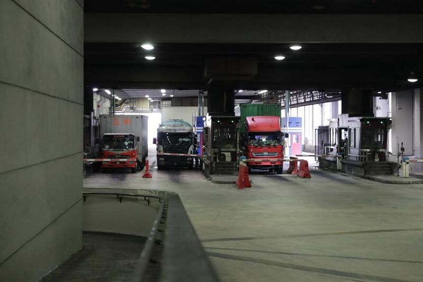 Delivery trucks entering Singapore Cargo Clearance Centre at Woodlands checkpoint from Malaysia on March 18, 2020.