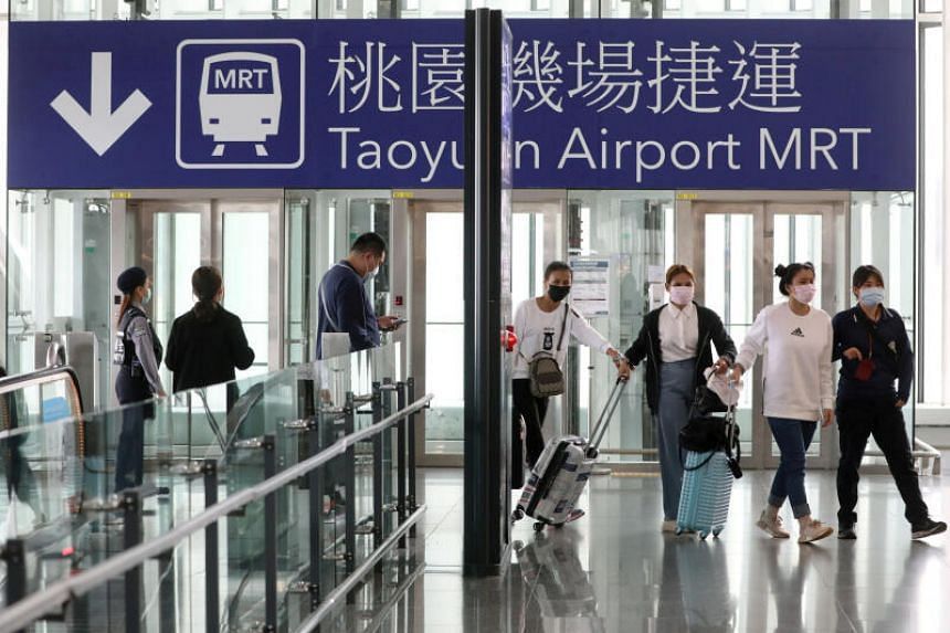 Travellers arrive at Taoyuan International airport as the Taiwanese government announced a ban for most foreigners entering the island, as part of preventive measures against coronavirus disease, in Taiwan, on March 18, 2020.