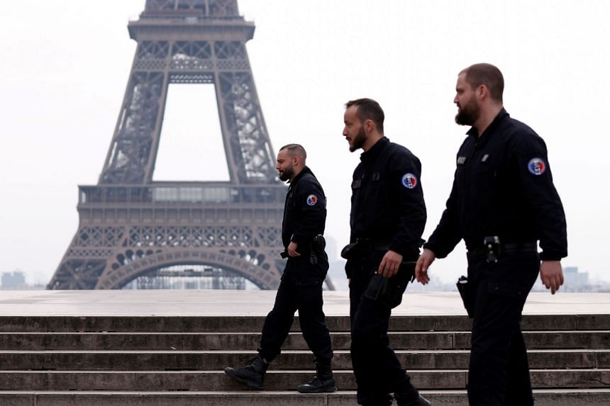 French police patrol at Tocadero square near the Eiffel tower in Paris during lockdown.