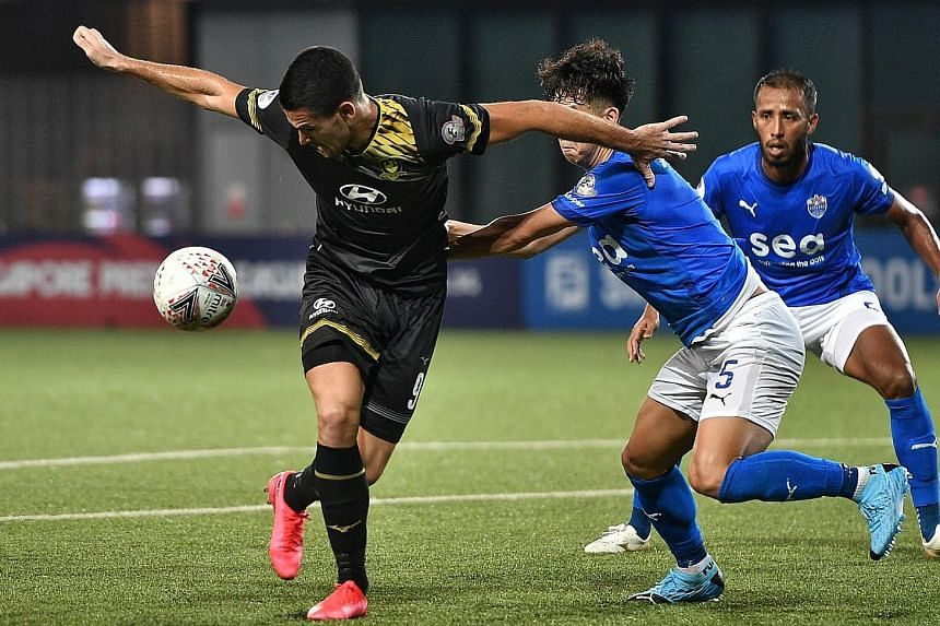 Tampines Rovers' Boris Kopitovic shielding the ball against Lion City Sailors players. He got the breakthrough on the hour mark to spark the 4-0 rout at Our Tampines Hub. ST PHOTO: ARIFFIN JAMAR