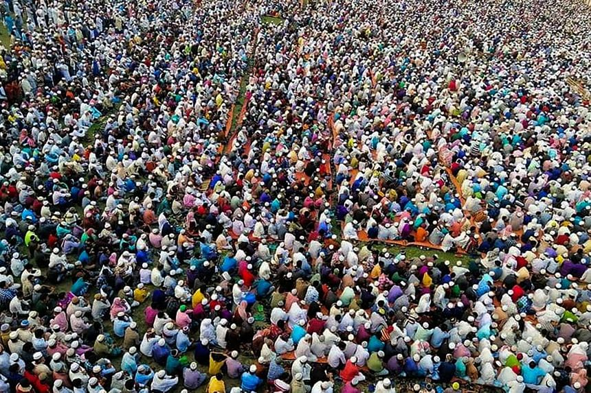 Thousands of Muslims attend a prayer session asking for safety amid concerns over the spread of the coronavirus, near Raipur in Lakshmipur district, on March 18, 2020.