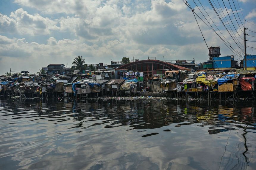 A general view of a slum area along the river in Manila on March 18, 2020. East Asia and the Pacific are home to 250 million slum-dwellers, many of them in China, Indonesia and the Philippines