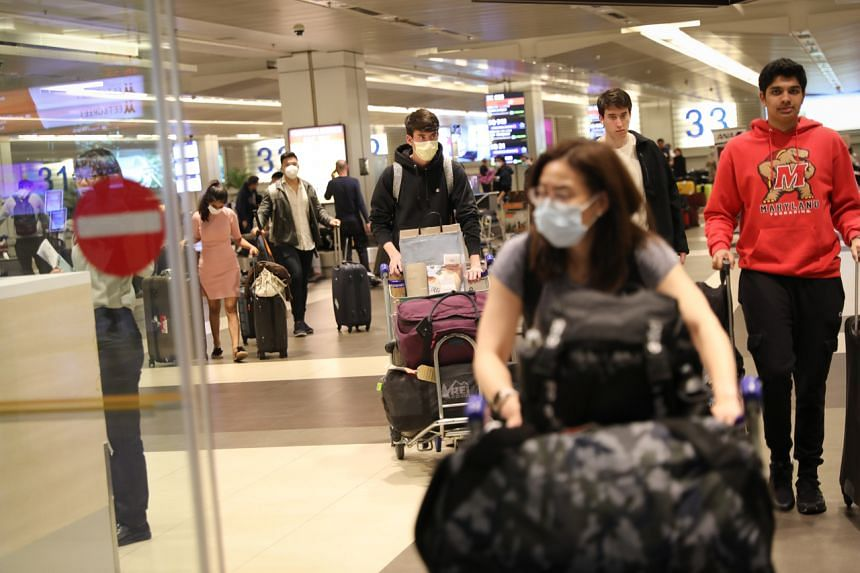 Travellers arriving from New York City at Changi Airport Terminal 2 on March 19, 2020.