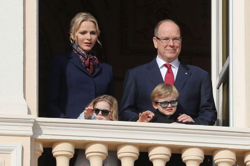 Prince Albert II of Monaco, Princess Charlene of Monaco, Prince Jacques and Princess Gabriella appear on the palace's balcony during Sainte Devote Celebrations in Monaco on Jan 27, 2020.