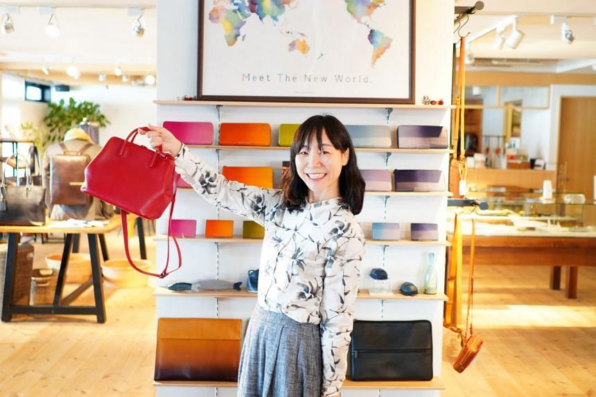 Motherhouse founder Eriko Yamaguchi with the Full Open Mini Boston bag, the brand's most popular model.