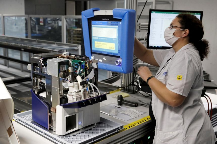 An employee of Hamilton Medical tests a ventilator at a plant in Switzerland on March 18, 2020.