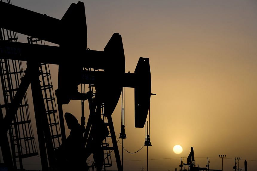 Oil pump jacks operate at sunset in Texas on Feb 11, 2019.