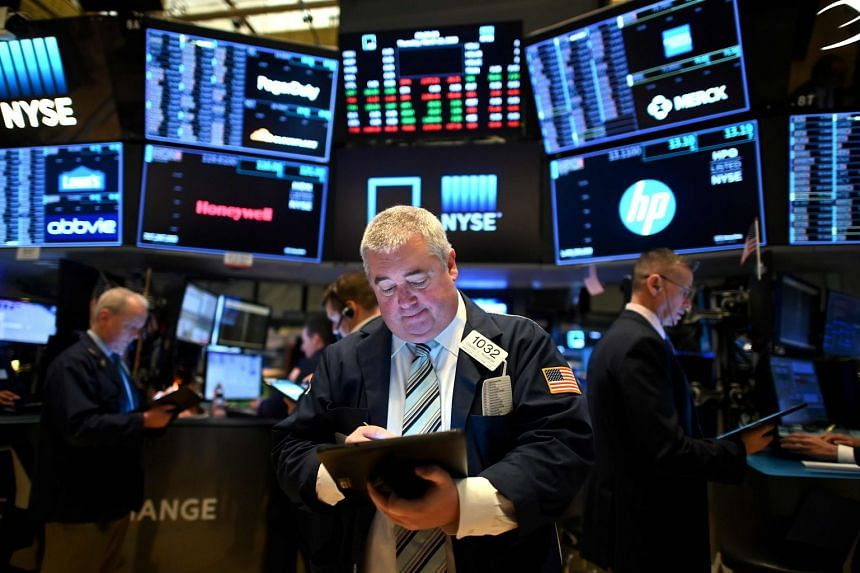Traders work during the opening bell at the New York Stock Exchange on March 19, 2020.