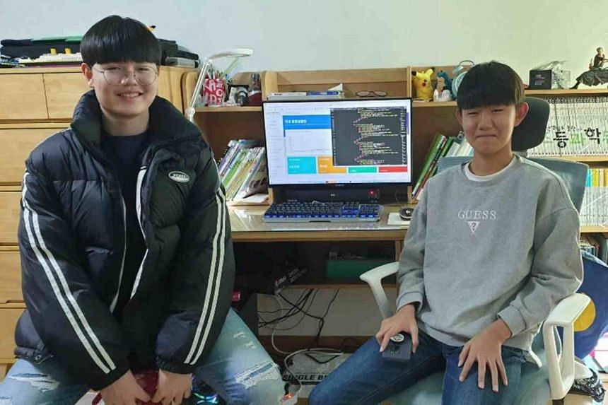 South Korean student Choi Hyoung-bin (left), 15, created the Coronanow website to offer useful information based on official data, such as charts on the increase in coronavirus cases and infections by regions. His friend Lee Chan Hyeong, 14, helps to