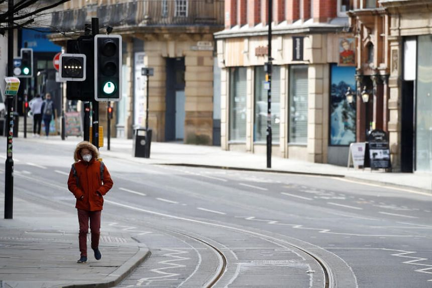 A deserted street amid the coronavirus outbreak in Manchester, Britain, on March 19, 2020.