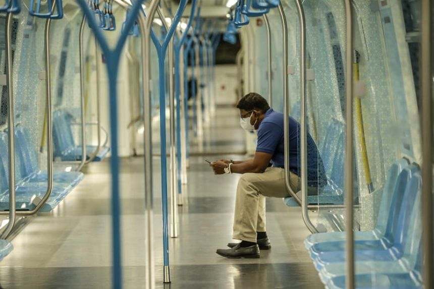 A passenger rides an otherwise empty train during rush hour in Kuala Lumpur on March 18, 2020, the first day of a national lockdown to curb the spread of the coronavirus.