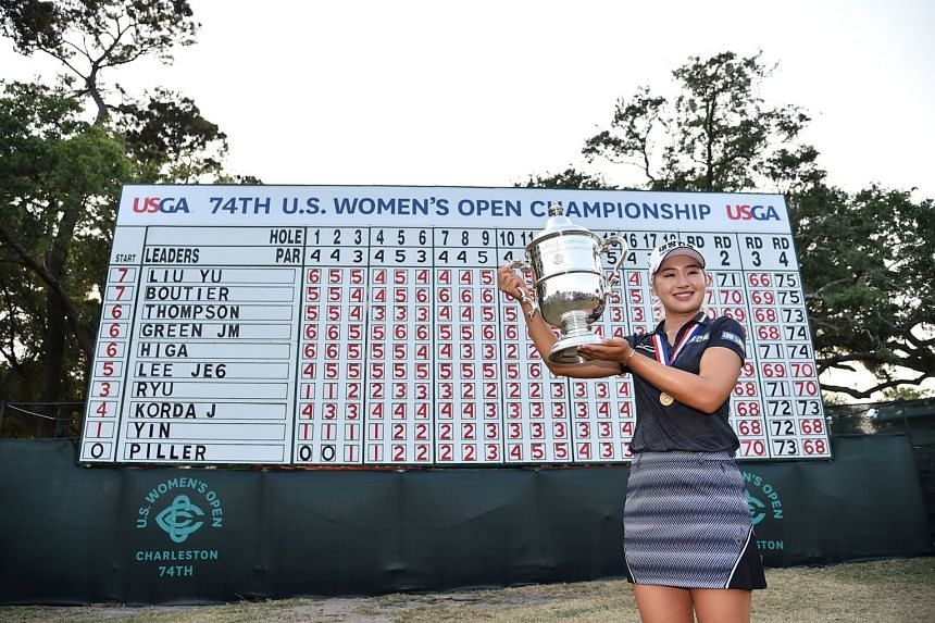 Jeongeun Lee holds the trophy after winning the US Women's Open golf tournament in June 2019.