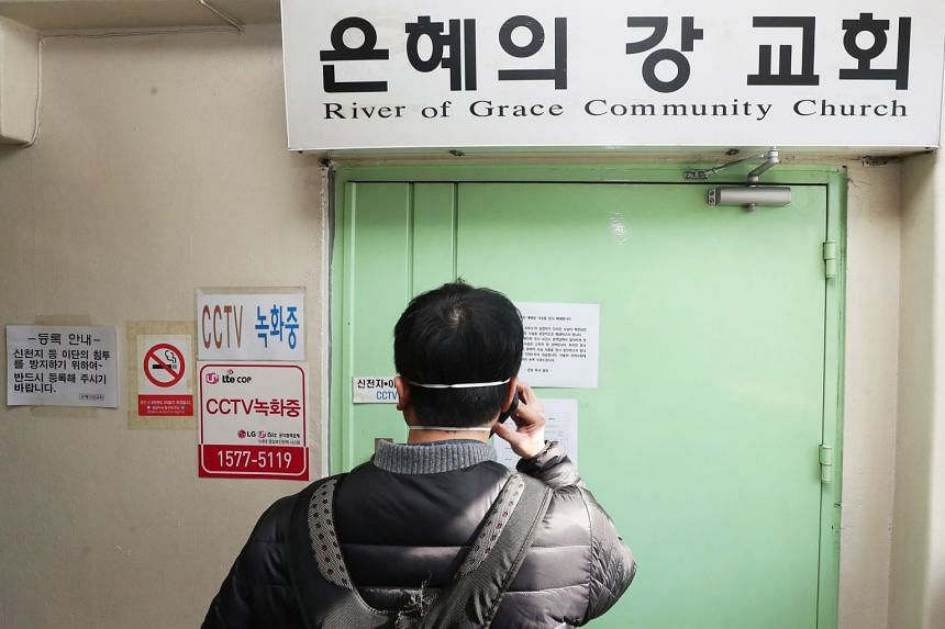 A man at the gate of the temporarily closed River of Grace Community Church in Seongnam, South Korea, on March 16, 2020.