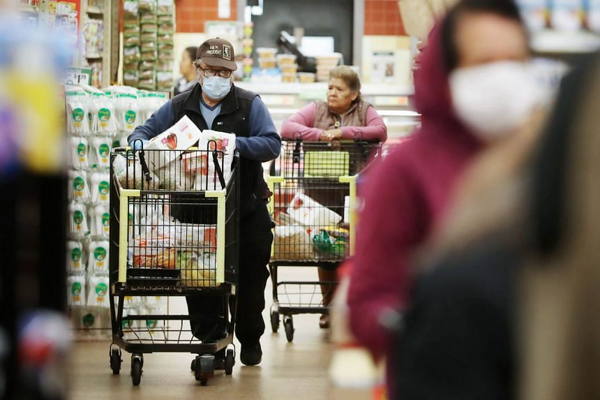 Seniors shop for groceries during special hours open to seniors and the disabled only at Northgate Gonzalez Market, on March 19, 2020, in Los Angeles, California.