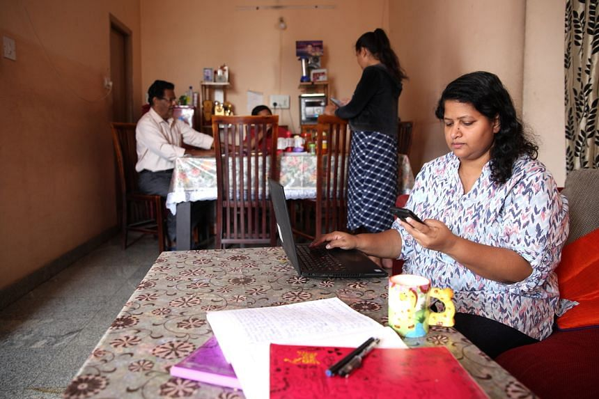 A woman working from her home in Bangalore on March 20, 2020.
