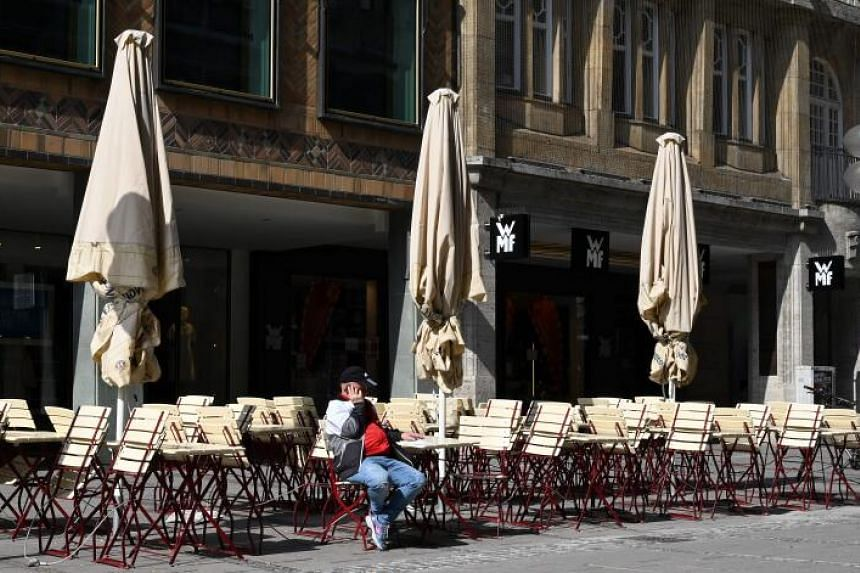An almost empty terrace is seen in the centre of Munich in southern Germany, where activities came to a halt due to the coronavirus pandemic, on March 20, 2020.