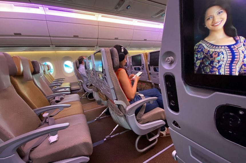 A row of empty seats seen on board a Singapore Airlines flight to Singapore from Jakarta International Airport, before the aircraft's departure from the Indonesian capital on February 18, 2020. Our Asian Insider podcast looks at the global economy on