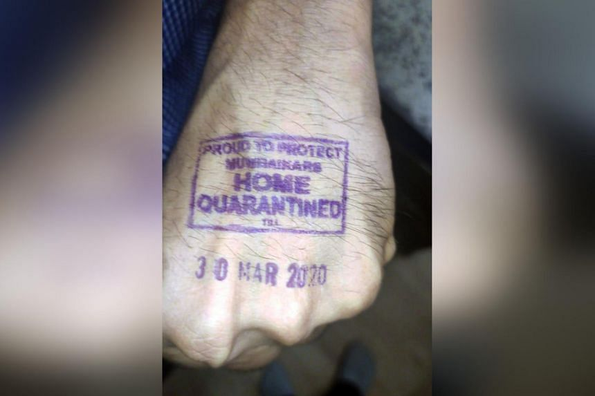 """An Indian shows his stamped hand, indicating that the person is under """"home quarantine"""", in Mumbai, India, on March 17, 2020."""