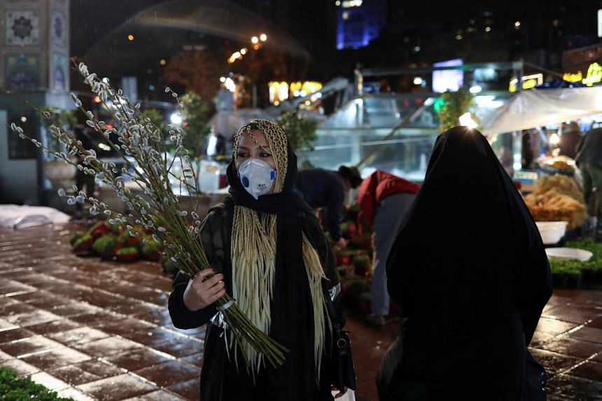 An Iranian woman wears a protective face mask in Teheran, Iran, on March 18, 2020.