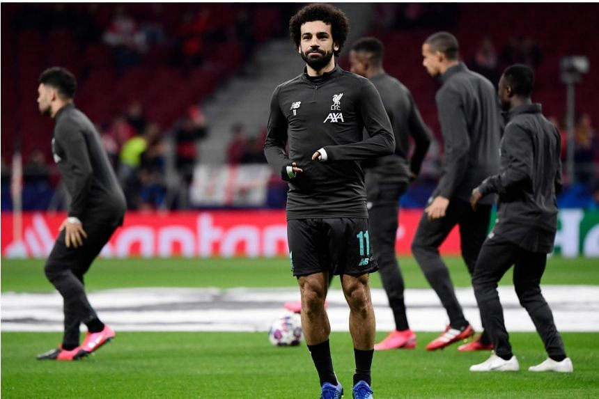Mohamed Salah warms up before the UEFA Champions League match between Club Atletico de Madrid and Liverpool FC at the Wanda Metropolitano stadium in Madrid, on Feb 18, 2020.