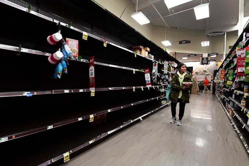 Grocery stores like this one in North Hollywood, California, are looking almost apocalyptic with aisles of empty shelves. Panic buying has made it nearly impossible for retailers and suppliers to keep up with the unprecedented spike in demand.