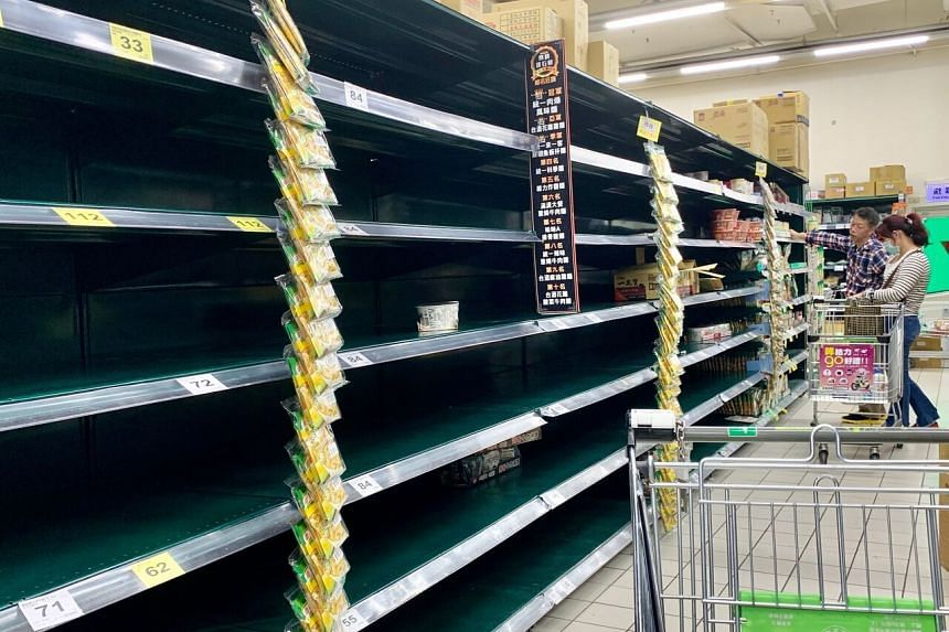 Empty shelves at a Carrefour supermarket in Xindian district, New Taipei City, on March 20, 2020.