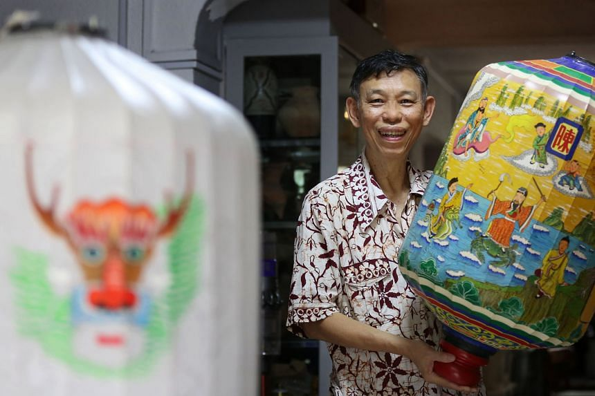 Mr Jimm Wong with a completed lantern he crafted. A heritage enthusiast with a keen interest in Chinese history and culture, he has been making lanterns since 2008. ST PHOTO: JOEL CHAN