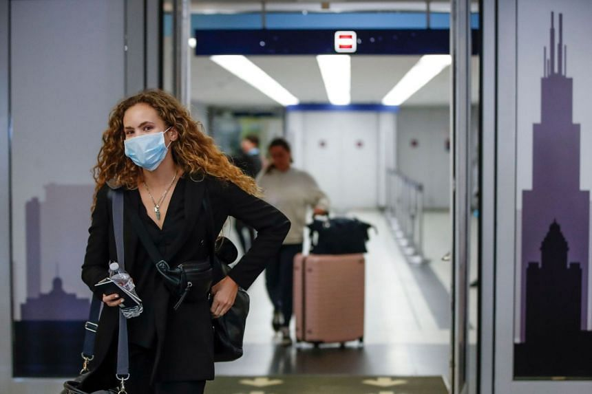 Travellers arrive at the international terminal of O'Hare Airport in Chicago, Illinois, on March 15, 2020.