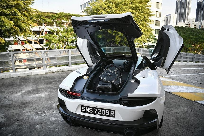 The McLaren GT is a creditable cross-country liner with a decent amount of comfort and practicality. The 4-litre twin-turbocharged V8 is placed lower on the chassis to free up more stowage area above it. The glass on the boot lid (above) is slightly