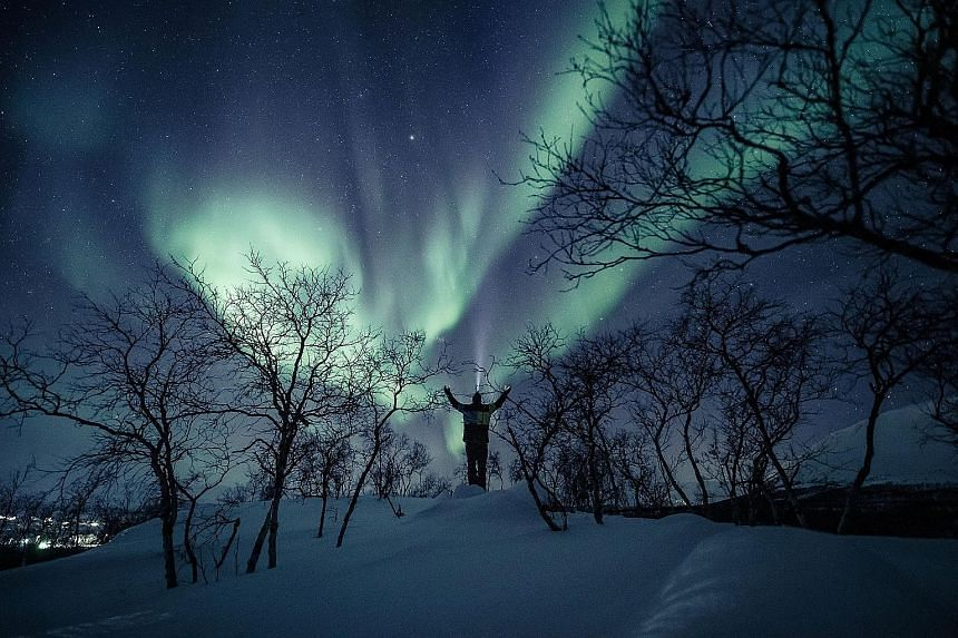 An aurora in the sky in the village of Kilpisjarvi in Finland, which has extended its lead over Denmark and Switzerland even as it once again tops the rankings in the World Happiness Report. Singapore is ranked 31st out of 153.