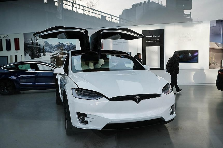 A Tesla car in a Manhattan dealership in January in New York. Tesla is expected to see a sales decline this year even with its much-anticipated Model Y crossover SUV.