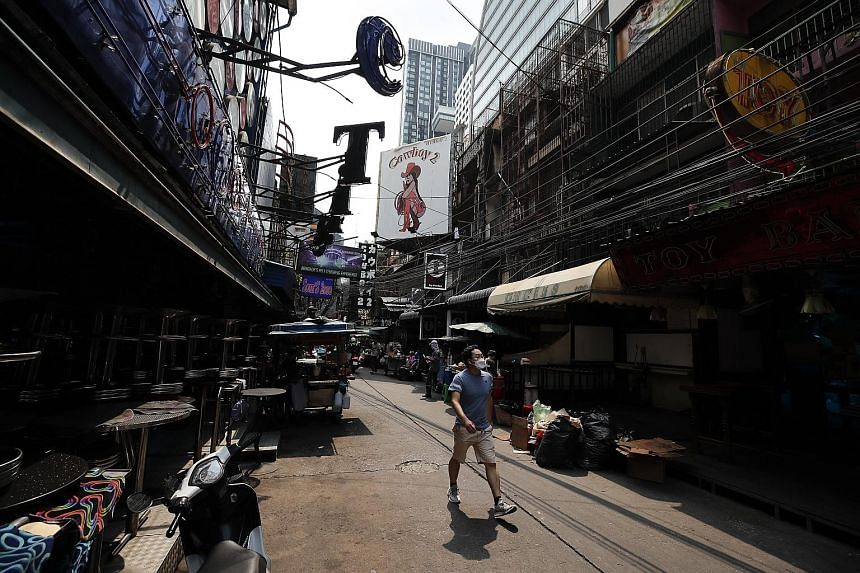 Bars and nightclubs were closed in a nearly deserted entertainment street in Bangkok yesterday, after a shutdown imposed from Wednesday.