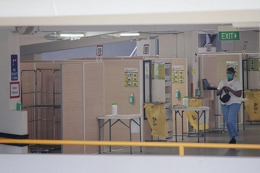 A screening area in a multi-storey carpark at Singapore General Hospital. Public hospitals have been reducing non-urgent operations and treatments since January to free up capacity for a possible spike in virus patients.