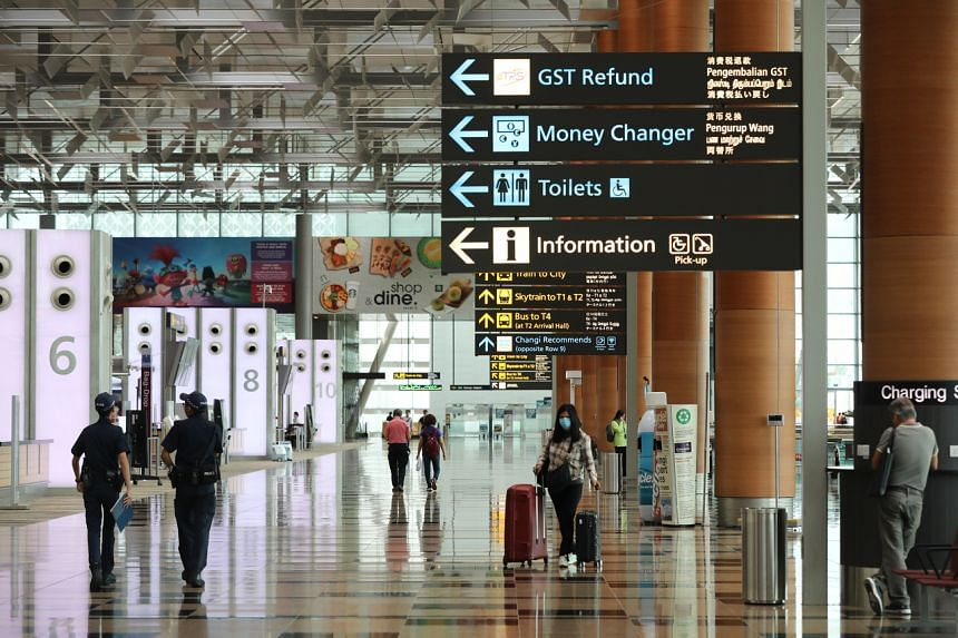 Travellers and visitors at Changi Airport Terminal 3 on March 19, 2020.