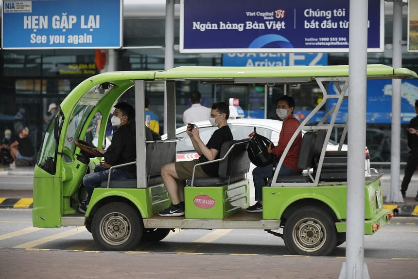 Travellers on a shuttle bus at Noi Bai International Airport in Hanoi on March 20, 2020. Vietnam's coronavirus cases rose to 94 as of March 21, with no deaths.