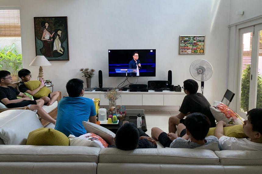 Youths watch the live-stream from Faith Community Baptist Church on a Sunday morning.