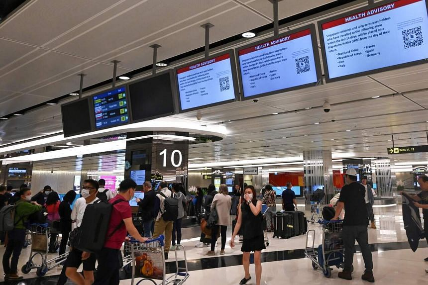 Travellers arriving at Changi Airport on March 16, 2020. All doctors in public and private hospitals have been advised by the Ministry of Health to immediately stop or defer accepting new foreign patients who do not reside in Singapore.