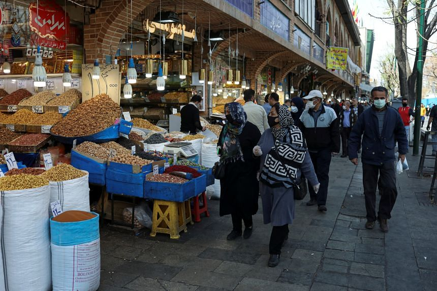 Shoppers at the Grand Bazaar in Teheran on March 20, 2020. Iran on March 21 announced 123 more deaths from coronavirus.