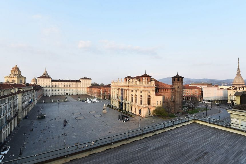 A nearly deserted square during the coronavirus emergency lockdown in Turin, Italy, on March 20, 2020.