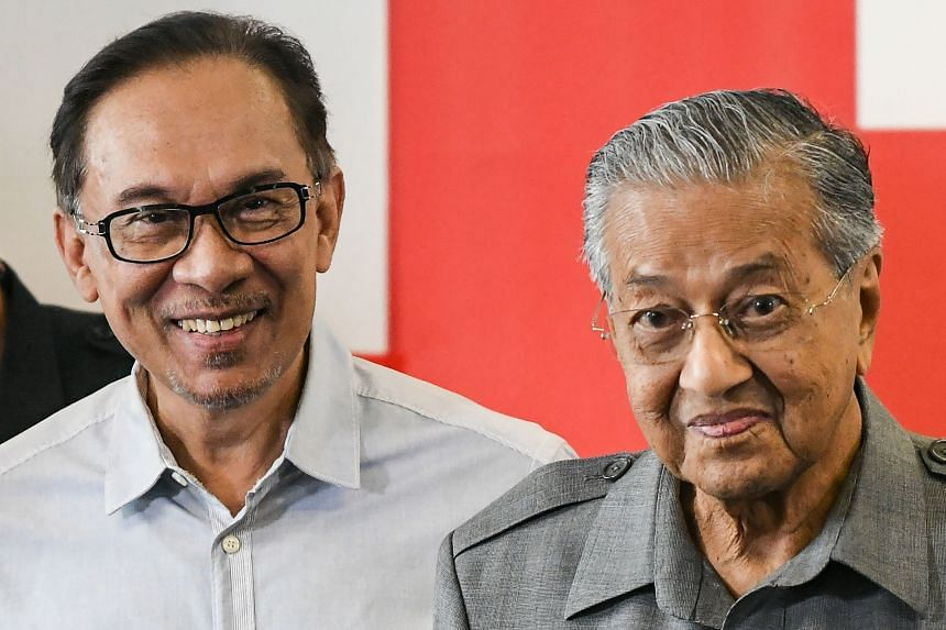 Malaysian opposition leader Anwar Ibrahim (left) had waited in the wings for nearly two years for former Prime Minister Mahathir Mohamad to fulfill a campaign pledge to eventually hand over the premiership to him.