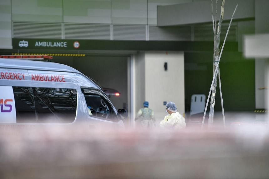 Medical staff at the back of National Centre for Infectious Diseases on March 16, 2020. Singapore reported its first two Covid-19 deaths on March 21, 2020.