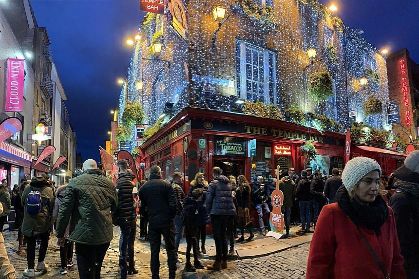 Enjoy music at The Quays Bar and Restaurant in Galway and take a swig of whiskey at the Temple Bar (above) in Dublin.
